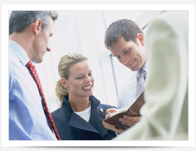 image of people smiling around a meeting table